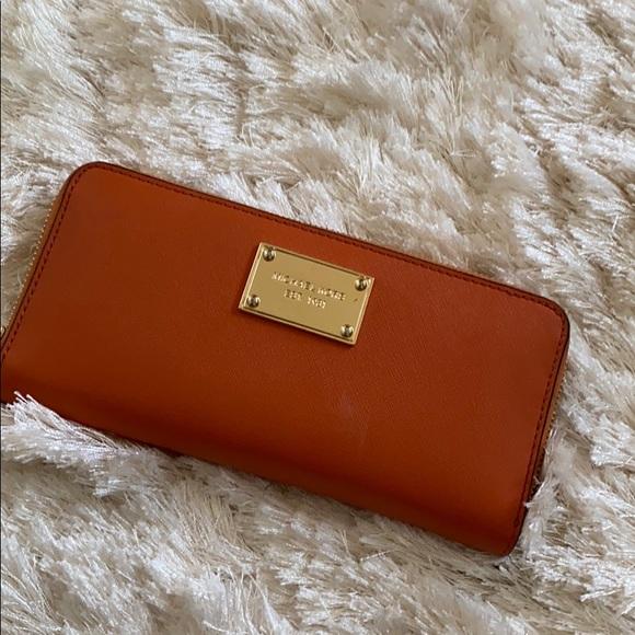 Michael Kors Handbags - Michael Kors Orange Large Wallet